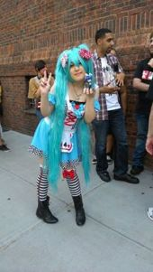 "Hatsune Miku cosplayer on line for the ""Magical Mirai 2013"" screening at New York City."